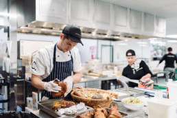 collective-hospitality-chef-preparing-pork-roasts-in-the-kitchen